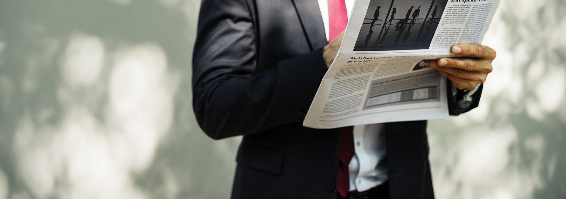 Man reading newspaper // Photo credit: rawpixel unsplash