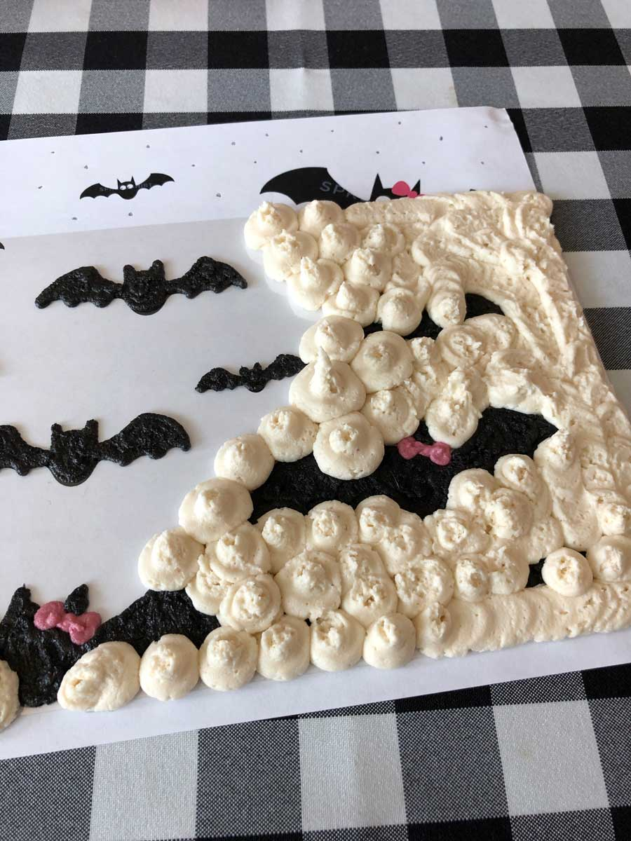 making a vegan buttercream transfer to wrap a 3-layer cake with
