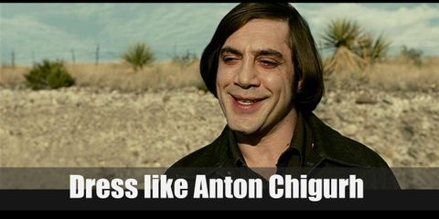 Anton Chigurh appears to wear a brown buttoned down shirt, a dark denim jacket, tough dark jeans, and leather boots.
