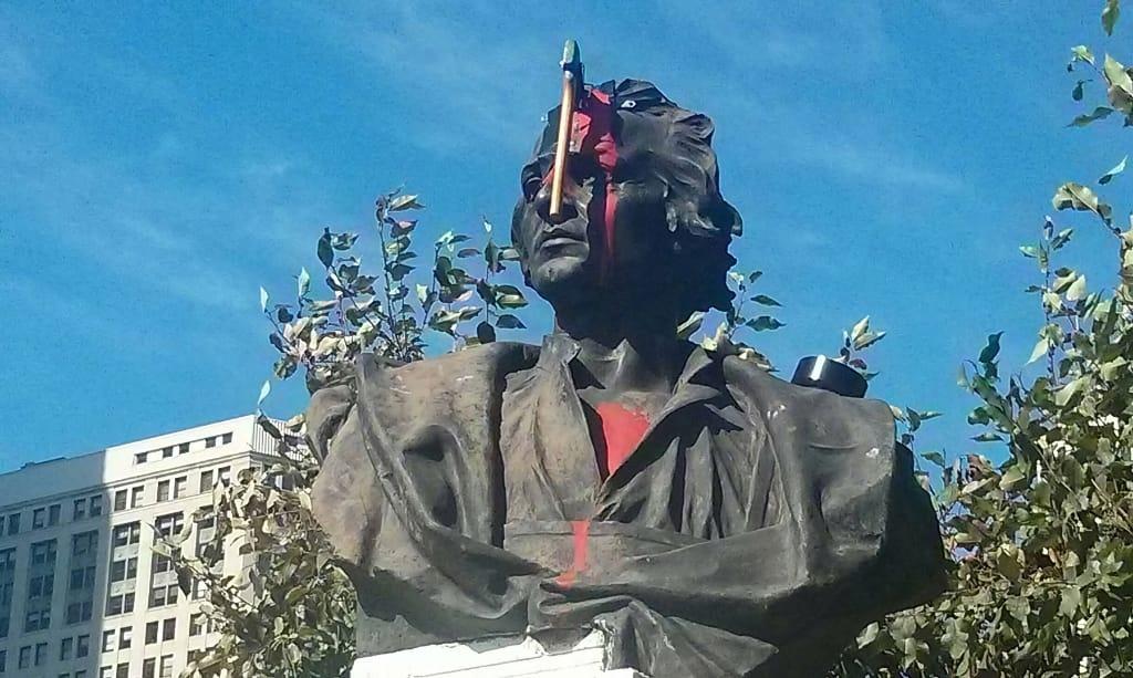 damaged Columbus statue