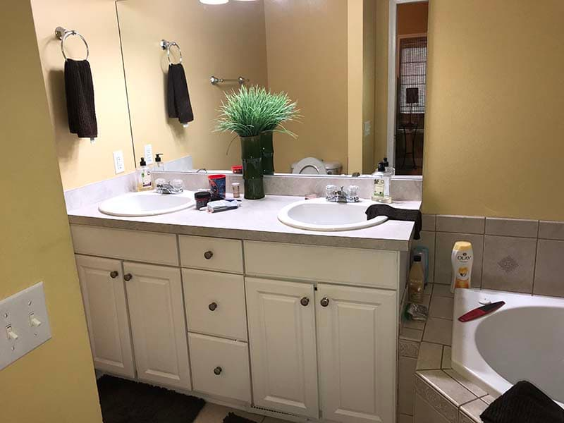 bathroom vanity and tub before a remodel by CorHome