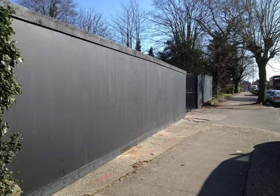 Wooden hoarding painted black