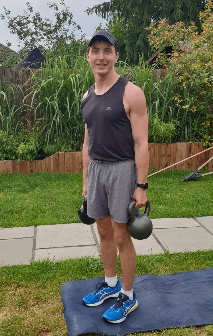 Luke holding two kettlebells