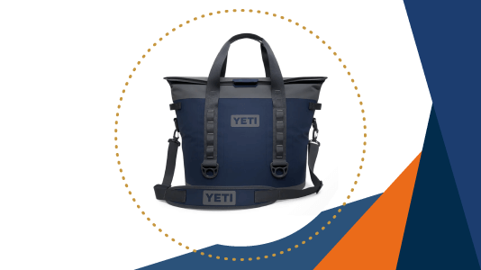 A navy blue YETI soft-sided cooler with a shoulder strap