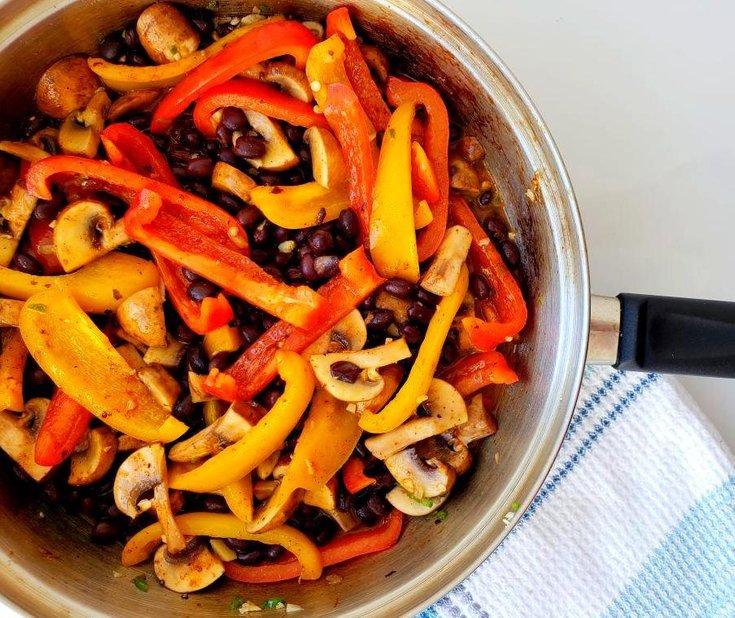 Pan with fajita peppers, mushroom, and black beans