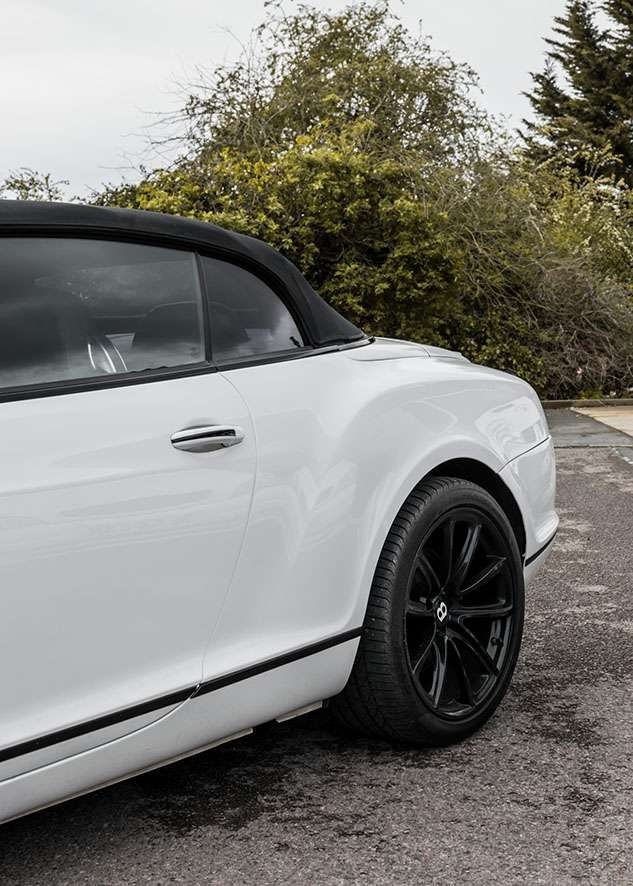 Bentley Continental GT car with untinted windows from side