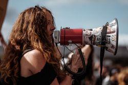 Woman shouting to a PA