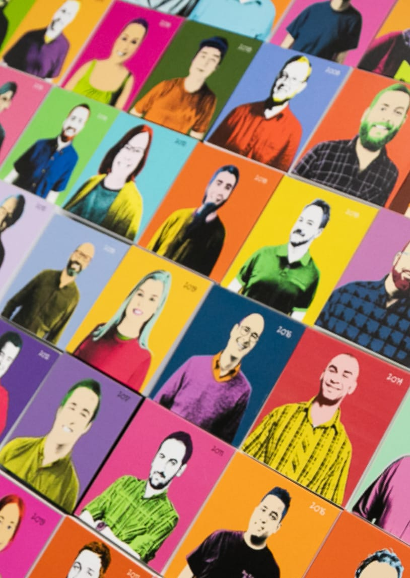 Pop art wall of MojoTech employee photos