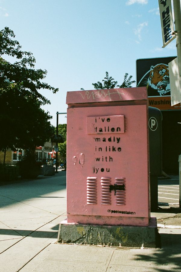 A distribution transformer painted pink that says 'I've fallen madly in like with you.'