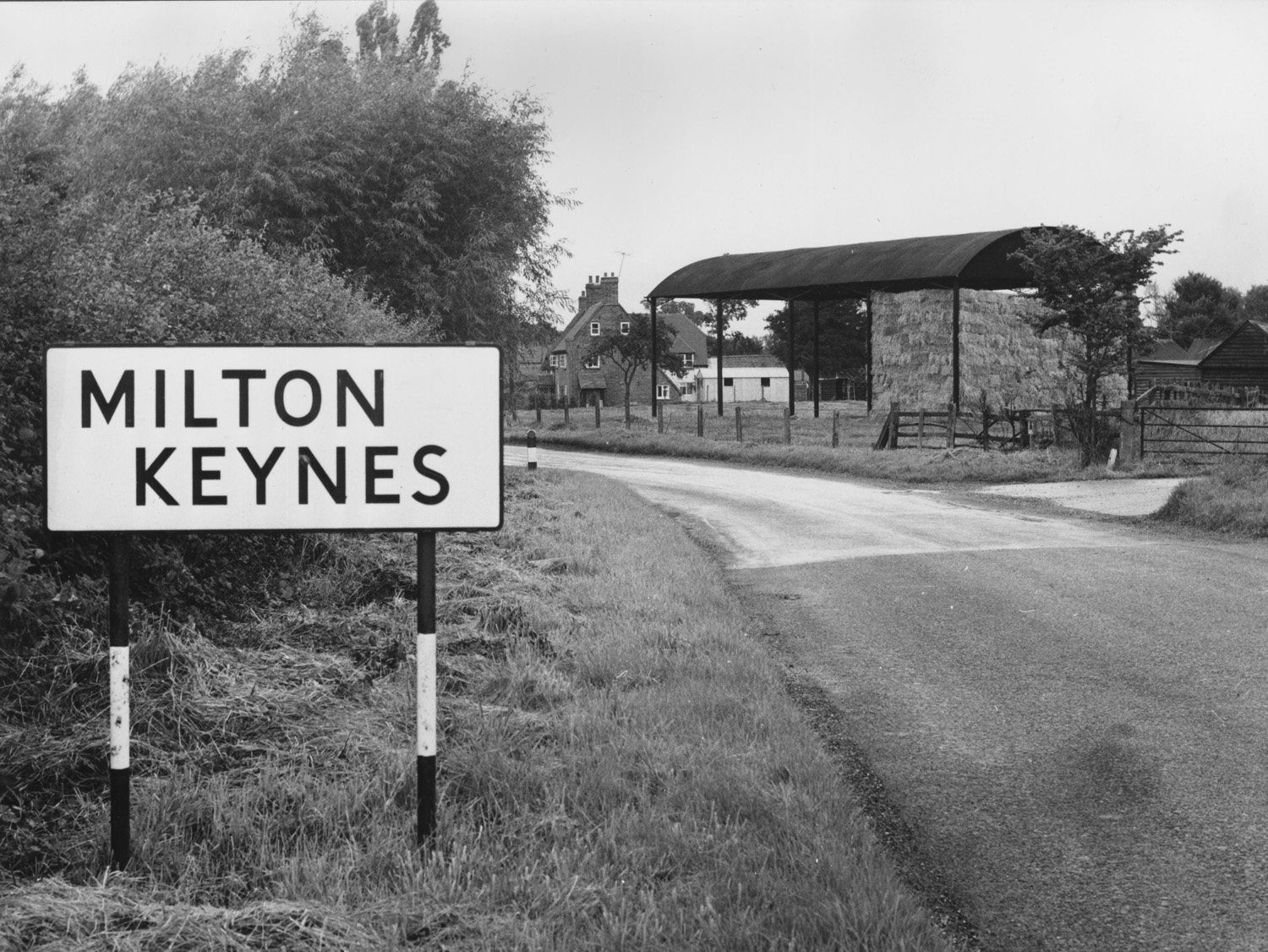 old black and white image of milton keynes road sign