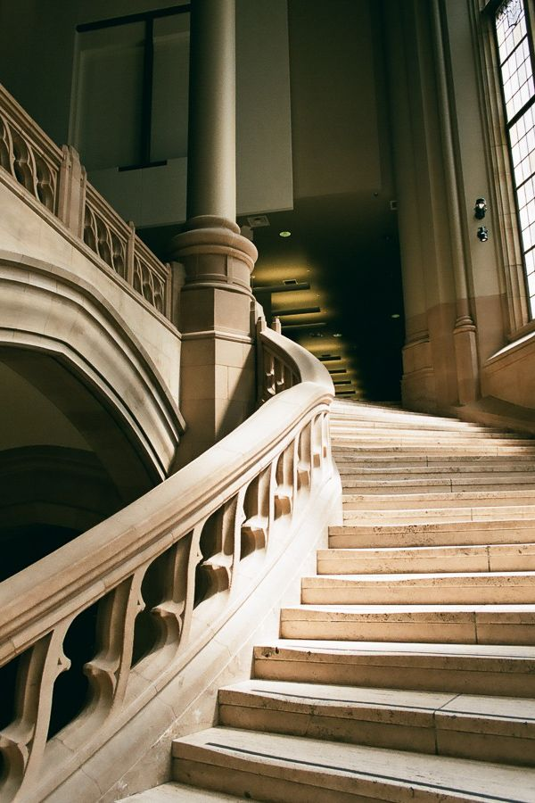 Grand marble staircase inside.