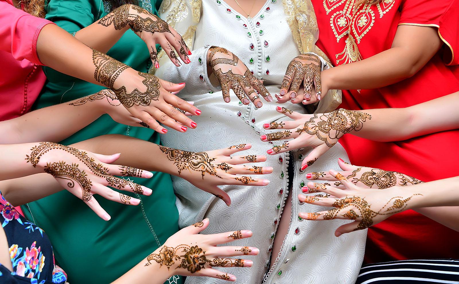 several women displaying henna tattoos