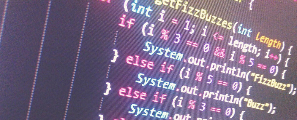 A photo of a screen showing FizzBuzz a popular albeit horribly ineffective coding exercise.