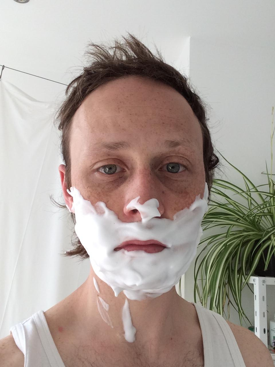 Pretty boy with a shaving cream beard.