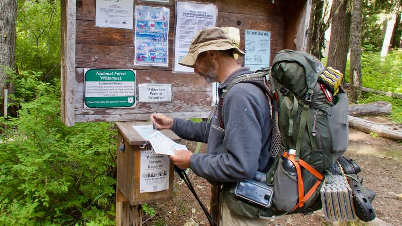 Ralph registers for a permit to enter Goat Rocks Wilderness