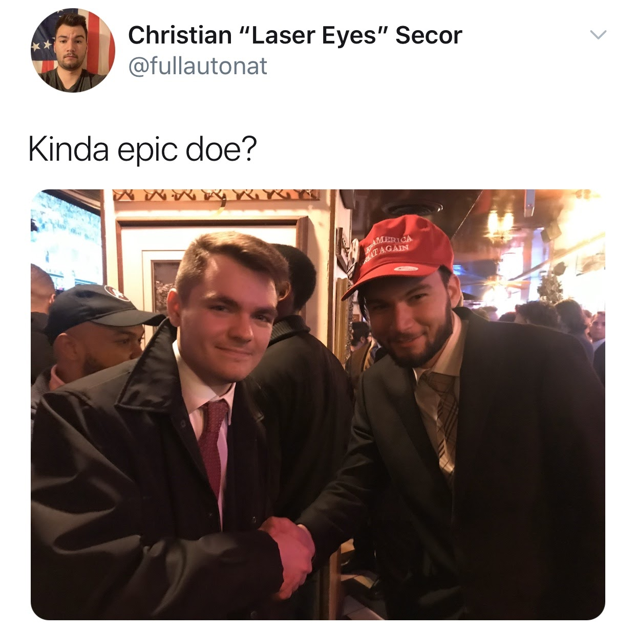Christian Secor poses with Nick Fuentes at an America First event