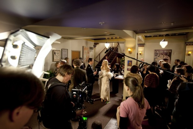 Kim Collier (foreground right) directs while a Red One camera is operated by a RoboCop-like suit wearing operator.