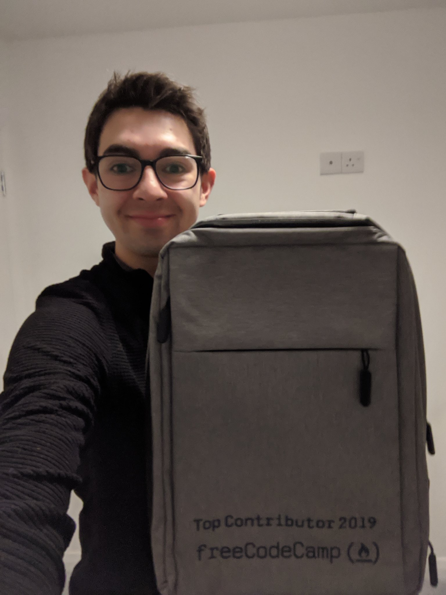 Here's me with my fancy Top Contributors backpack. Woohoo!