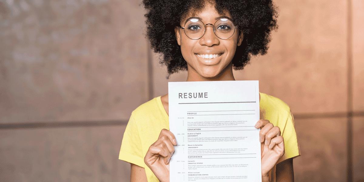 A UX designer holding up her resume