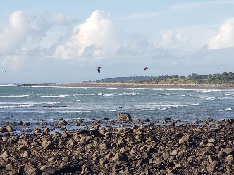 Watching the kite surfers along the Coastal Walkway