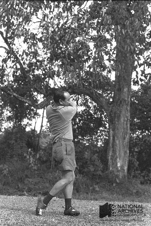 Dr Goh taking a swing shot at Bukit Club, Sime Road, 1965. Ref: 19980000605 - 0030