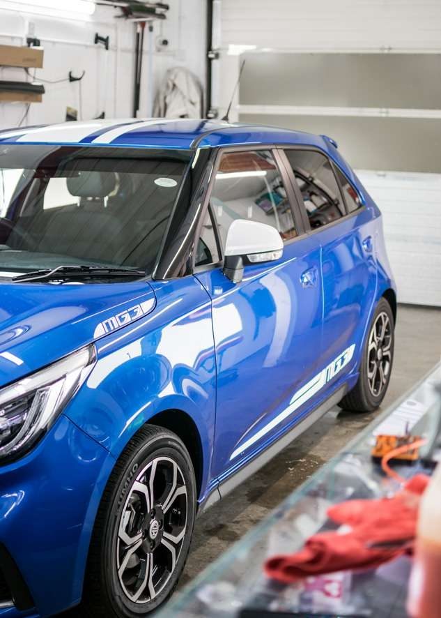 Blue MG3 car with tinted windows from front