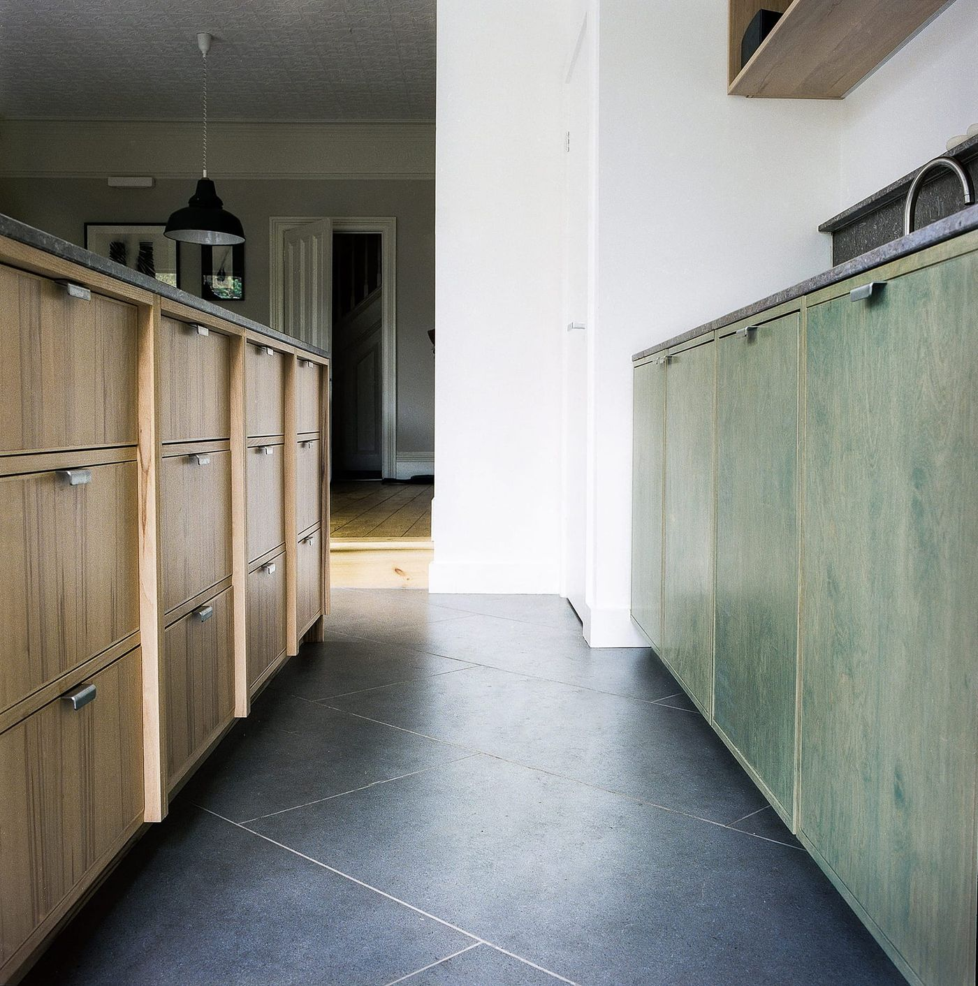 Moss green stained birch plywood, steamed beech and fossil mandale limestone bespoke kitchen at Southgrove Road designed by From Works.