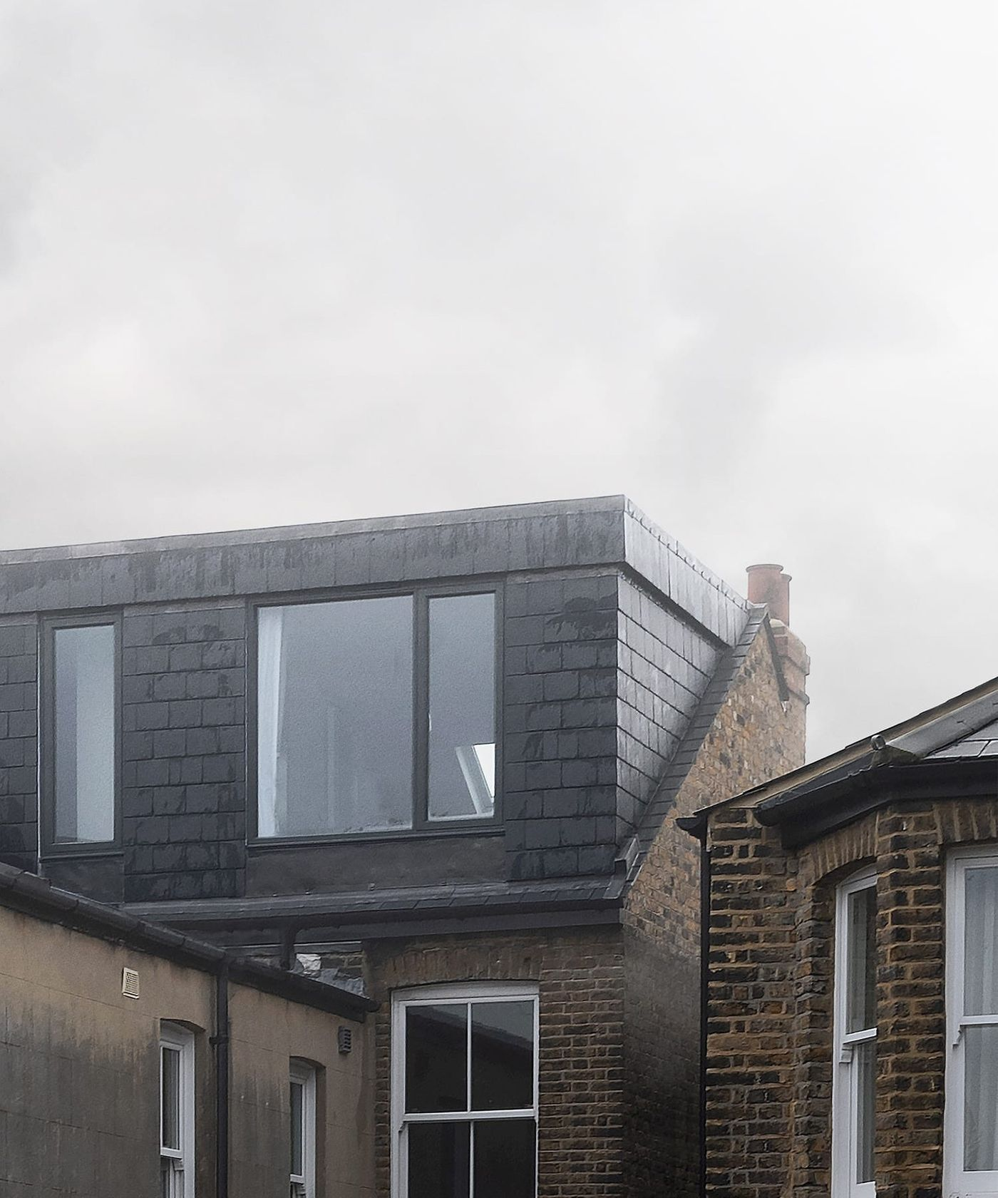 External view of the slate and lead clad new rear dormer extension at Northbrook Road designed by From Works.