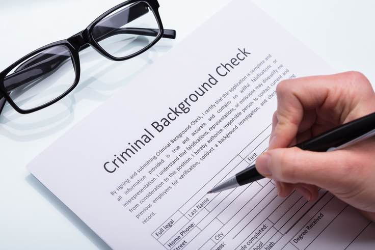 Filling out criminal background check paperwork