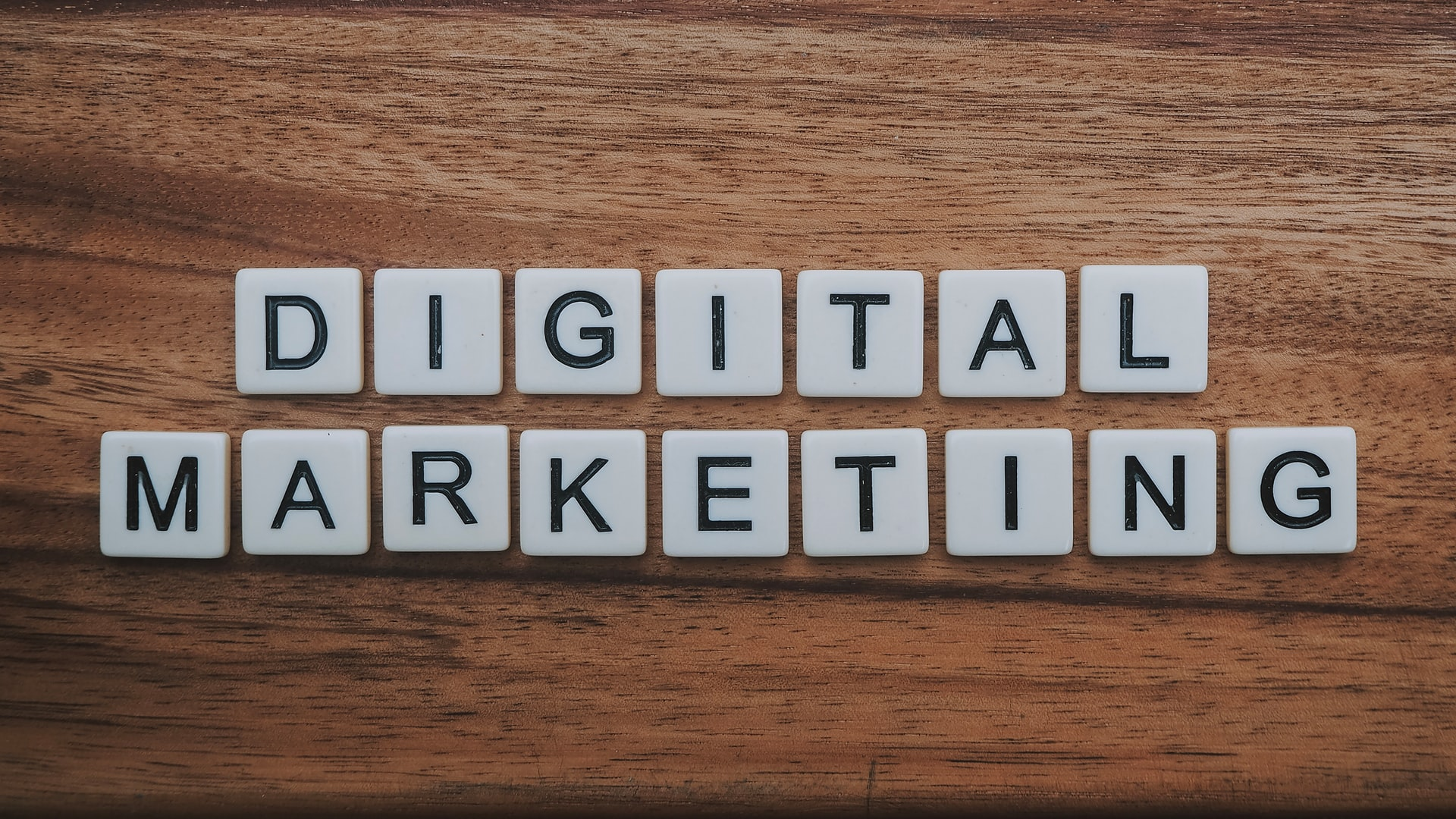 Letters reading Digital Marketing on a wooden table