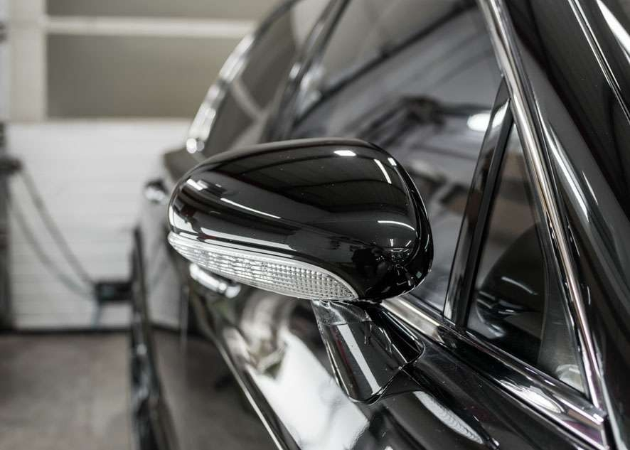 Close up shot of Bentley Flying Spur side mirror with scratches removed by polishing, paint correction and paint enhancement