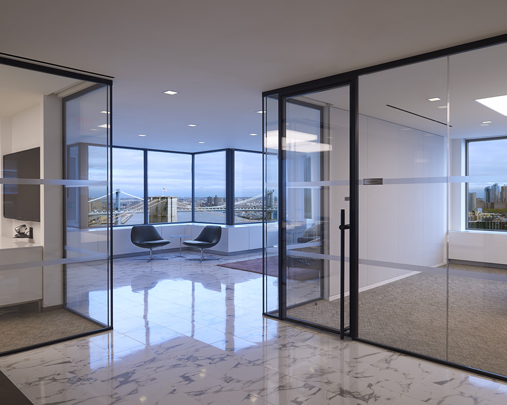 Hallway With Glass Walls and Doors