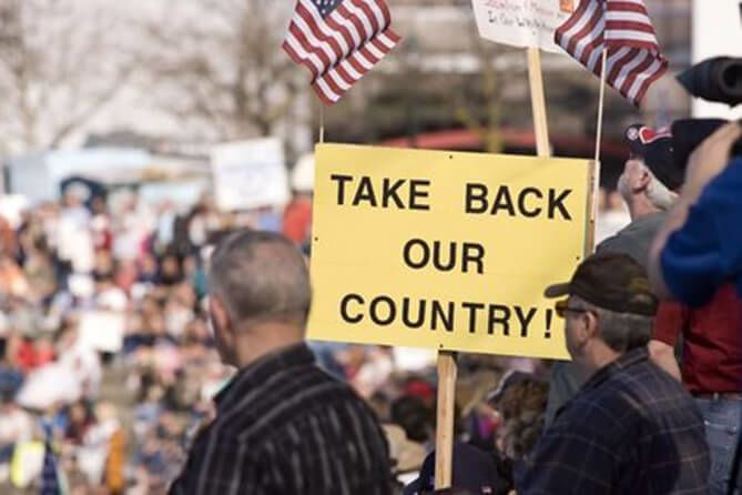 Protestors with Take Back Our Country sign