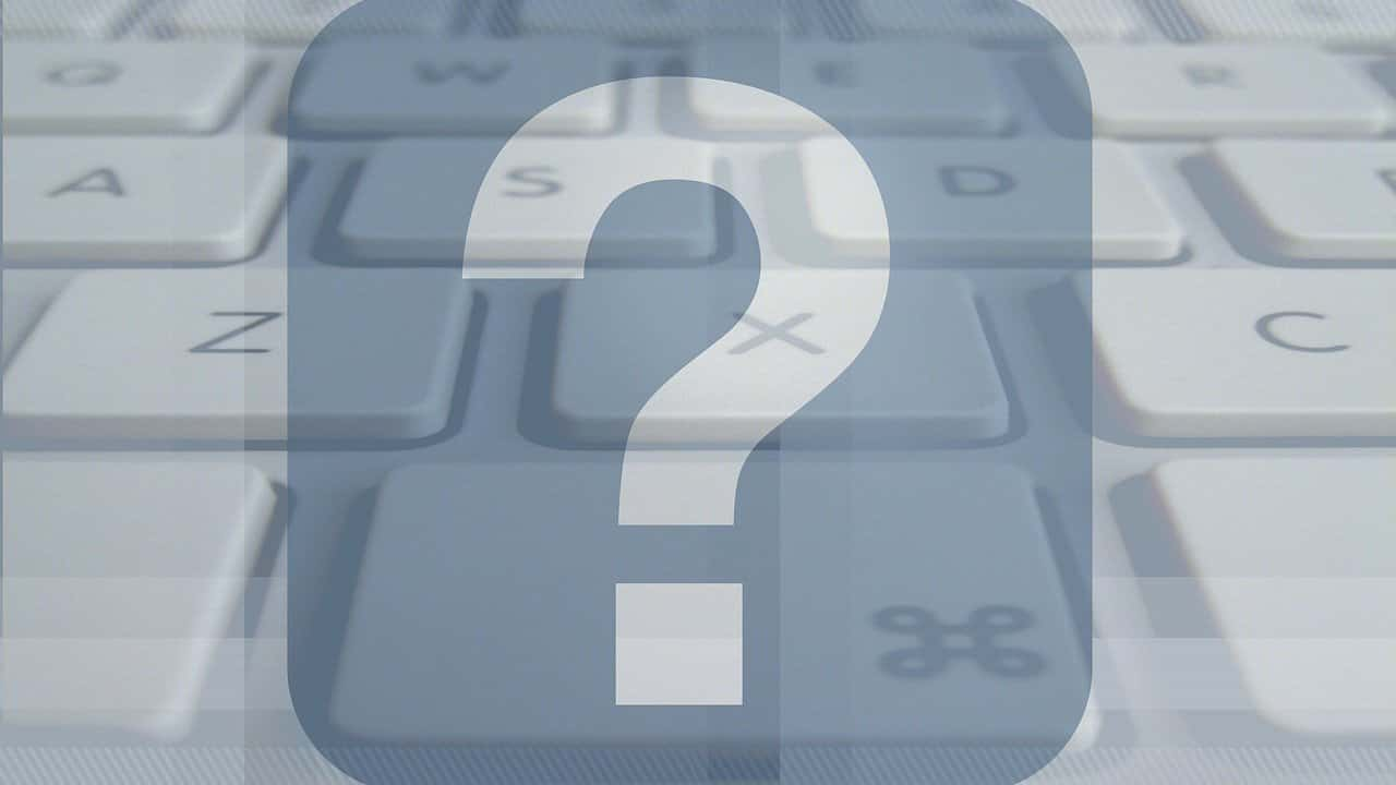 Stylistic image of question mark superimposed over computer keyboard