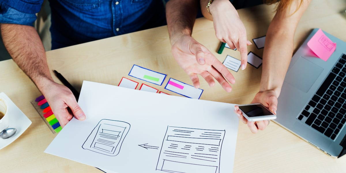 Two UX designers in the middle of the UX design process