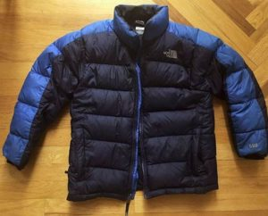 The North Face Nuptse ultralight down jacket on a floor
