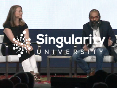 Ashish Gadnis sitting with a lady at the Singularity University