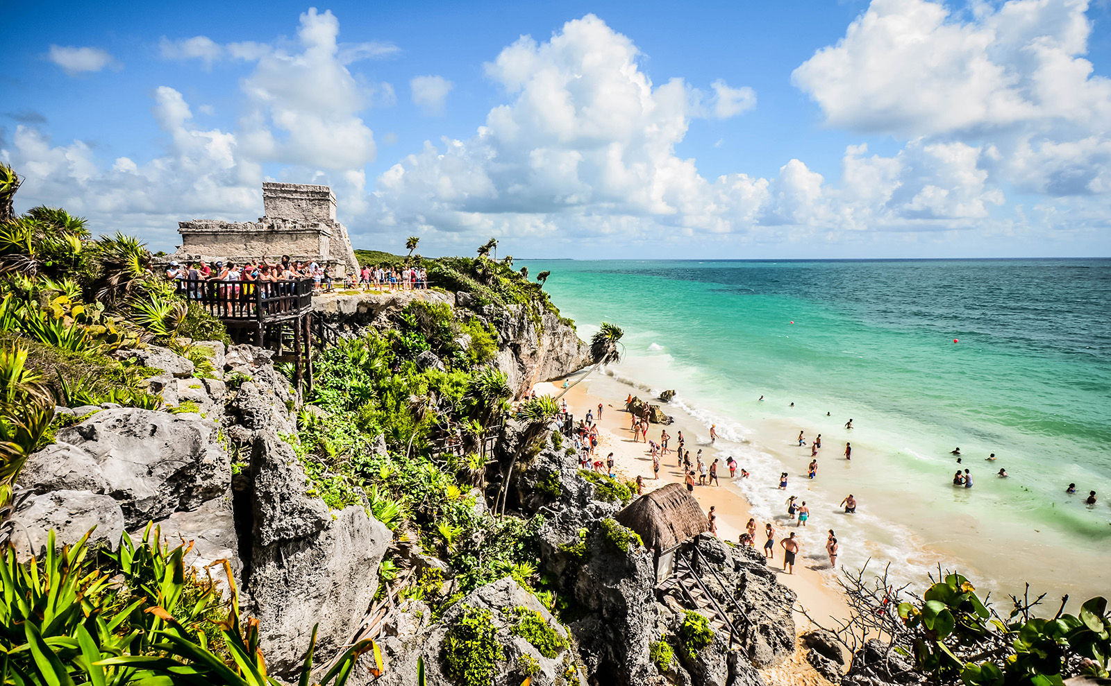 mayan ruins on a cliff above a beach in tulum, mexico