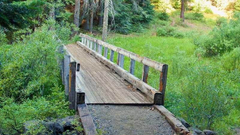 A bridge over Grizzly Creek near an aqueduct