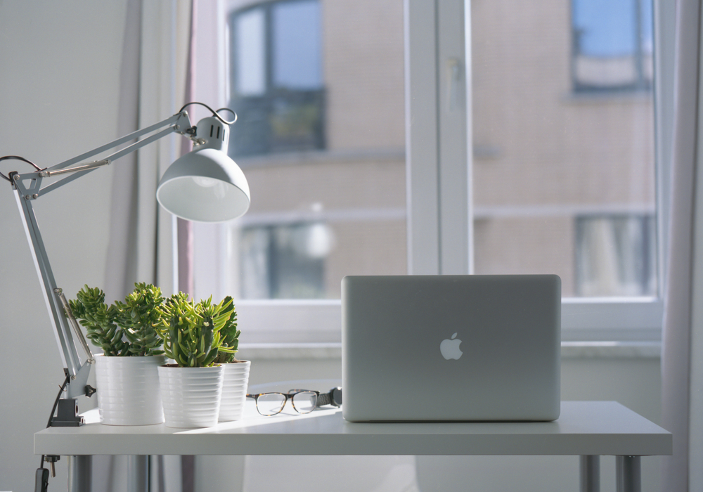 image of workspace with laptop and desk lamp