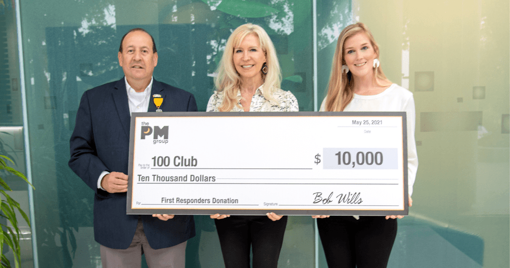 An image of The PM Group President Fran Yanity presenting a $10000 to the 100 Club