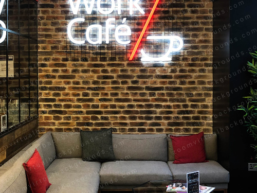 Cafe Virtual Background for Zoom with cosy corner sofa and neon sign saying work cafe