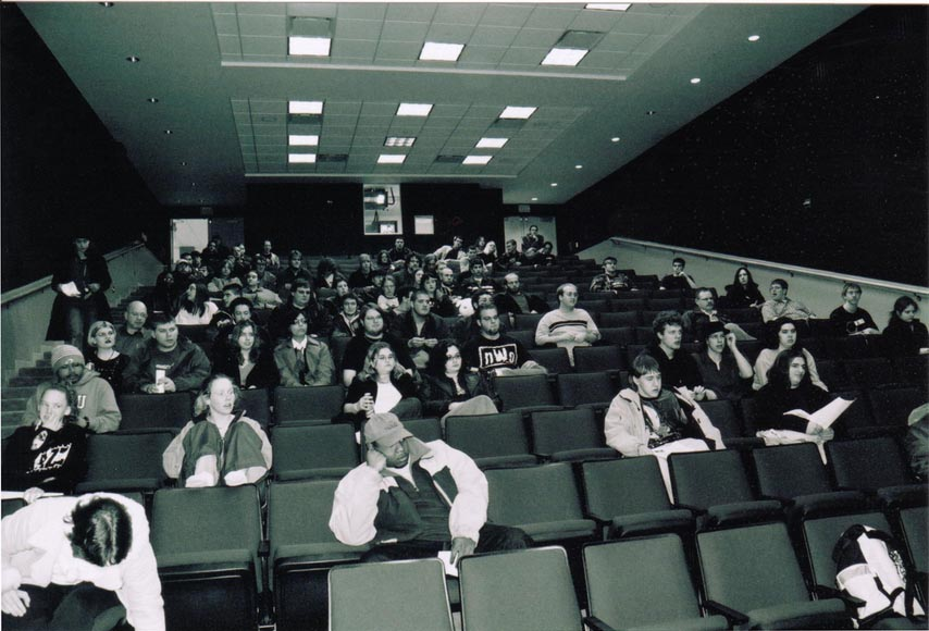 A monochorme picture of an early ANO meeting in the Bowen Thompson Student Union Theater.