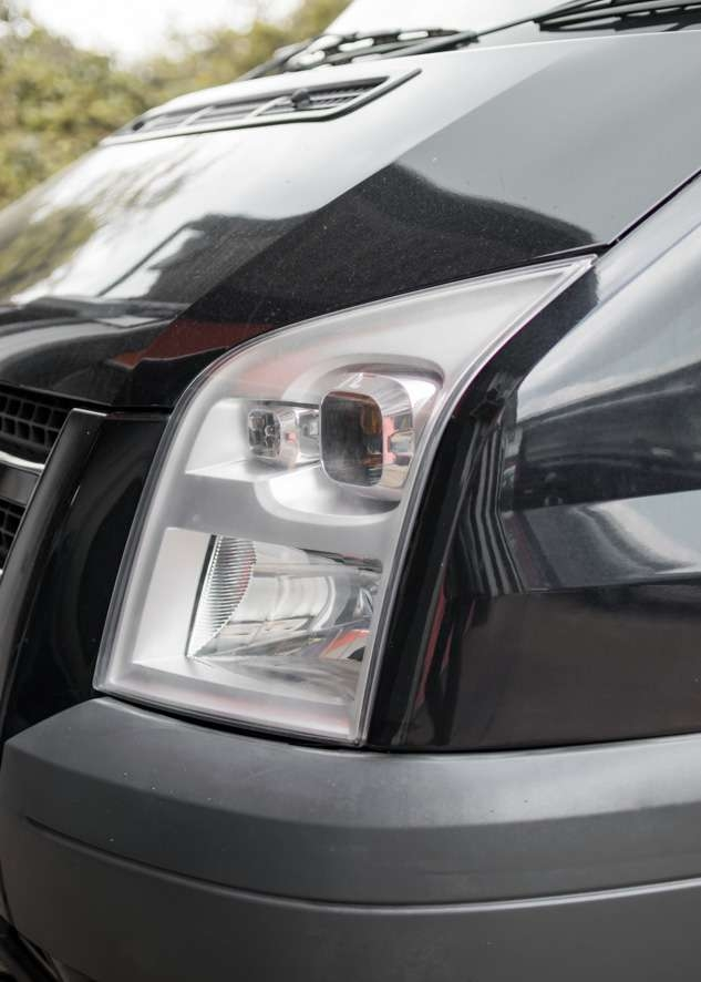 Close up shot of left side Ford Transit cloudy/foggy headlight before headlight restoration