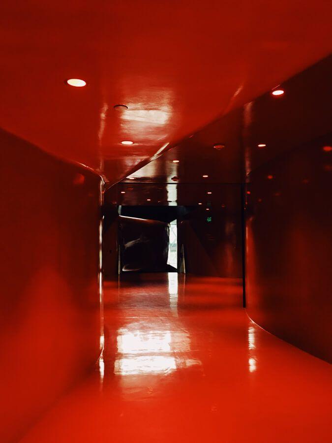 Empty hallway that's floor to ceiling red