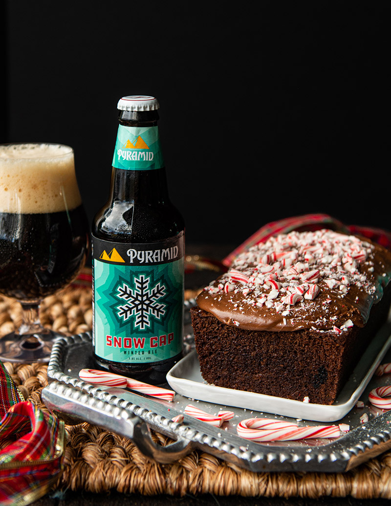 Christmas chocolate peppermint cake recipe, Snow Cap Loaf Cake served with Pyramid's seasonal Snow Cap Winter Ale and garnished with peppermint candy canes, overhead view
