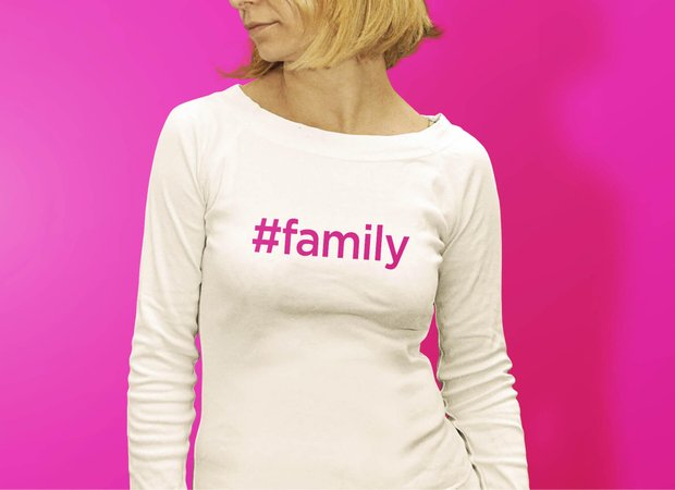 A lady wearing a t-shirt with the hashtag #family written on it