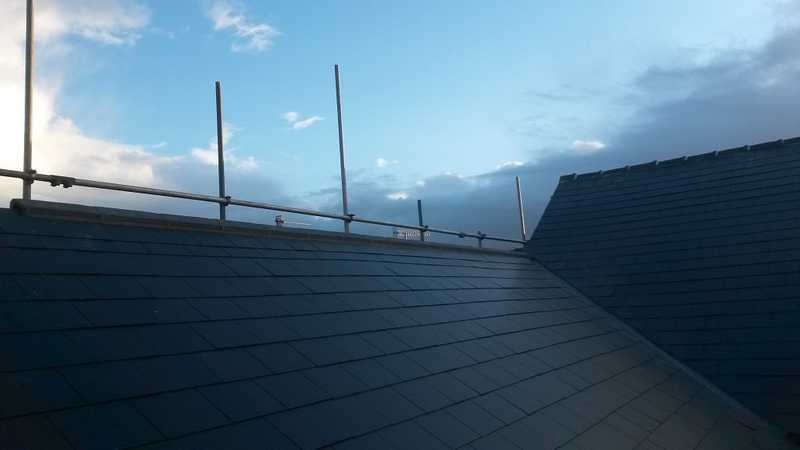 A finished roof valley having been repaired due to the effects of seasonal weathering