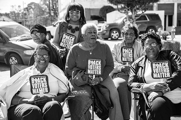 six African-American women holding fans printed withBlack Voters Matter