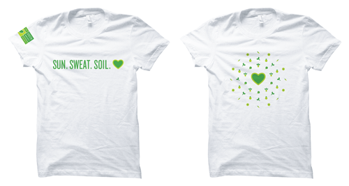 Two t-shirts, one that says Sun, sweat, soil, the other has an abstract pattern made of vegetable illustrations